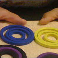 Froebel gift play (concentric rings)